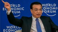 A handout picture provided by the World Economic Forum shows Chinese Prime Minister Li Keqiang during the Annual Meeting of the New Champions 2014 during the World Economic Forum in Tianjin, China, on 10 September 2014