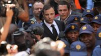 Oscar Pistorius leaves on bail from the North Gauteng High Court on 12 September 2014 in Pretoria, South Africa.