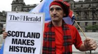 A pro-independence supporter is pictured in George Square in Glasgow, Scotland, on 19 September, 2014