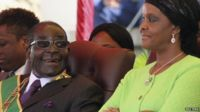 Zimbabwe's President Robert Mugabe and his wife Grace attend a rally in Harare, 12 August 2014