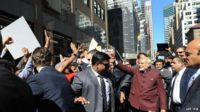 Narendra Modi (right) walks the streets of Manhattan