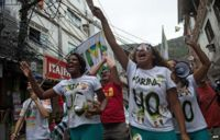 Supporters of candidate Silva in the Rocinha favela in Rio de Janeiro 30 August 2014