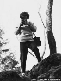 Shirley Baker taking a picture with her Rolliflex camera
