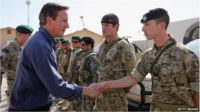 David Cameron shakes hands with a British soldier at Camp Bastion