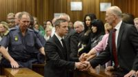 Oscar Pistorius and his uncle Arnold Pistorius at the high court in Pretoria, South Africa on 21 October 2014