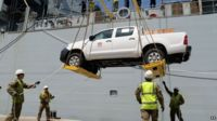 Pick-up trucks being offloaded from RFA Argus