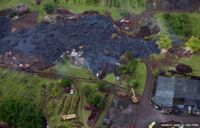 Construction crews try to divert lava from the Kilauea volcano as it nears a home in the village of Pahoa, Hawaii