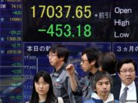 Share prices displayed on a billboard in Japan, 17 November 2014