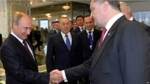रूस के राष्ट्रपति पुतिन और यूक्रेन के राष्ट्रपति पोरोशेंको