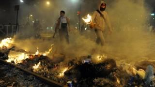 Protestos em Caracas nesta quarta (AFP)