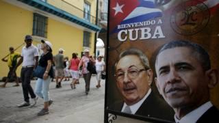 Плакат в Гаване с Бараком Обамой и Раулем Кастро