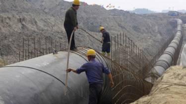 Obras de transposição de água na China, em foto de março de 2014 (Reuters)