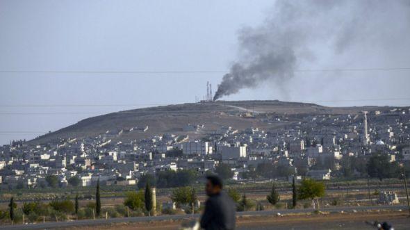 """عالمي تقرير ديلي تلغراف يتهم قطريين بتمويل """"إرهابيين"""" سوريا والعراق 141003193428_kobani_"""