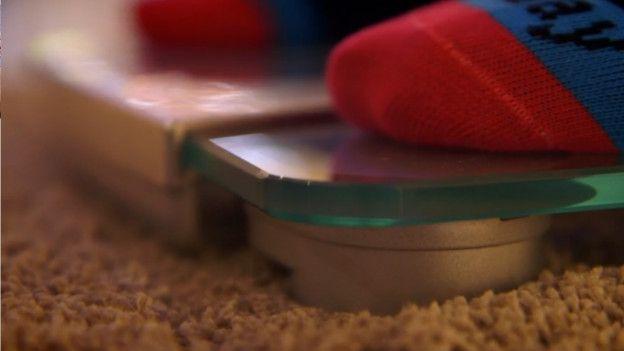 Balanza en alfombra