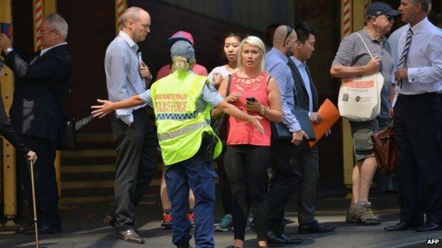 Personas a la espera de noticias en Sidney