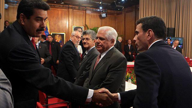 Nicolás Marudo y Henrique Capriles