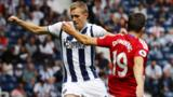 West Brom's Darren Fletcher in action with Mddlesbrough's Stewart Downing
