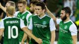 John McGinn is consoled by team-mates after his penalty miss