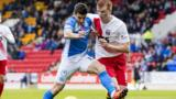 Michael Coulson of St Johnstone and Kilmarnock's Scott Boyd jostle for possession