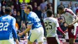 Hearts' Arnaud Djoum (right)  heads in pulled a goal back