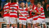 Liam Mandeville (second right) celebrates his late Doncaster Rovers winner