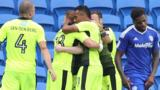 Reading players celebrate with Yann Kermorgant after his late winner