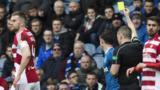 Referee John Beaton yellow carded Rangers striker Joe Garner for a wild challenge on Hamilton's Dougie Imrie