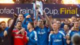 Rangers players celebrating with the Scottish Challenge Cup trophy