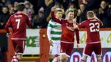 Jonny Hayes celebrates his excellent strike against Celtic