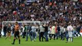 Millwall fans on the pitch at Wembley