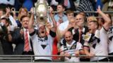 Hull FC captain Gareth Ellis lifts the Challenge Cup