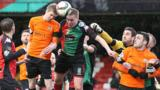 Glenavon's Rhys Marshall is challenged by Glentoran's Calum Birney during Saturday's Irish Cup sixth round tie at the Oval