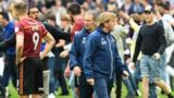 Stuart McCall with Millwall fans on the pitch