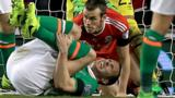 John O'Shea looks in severe pain after the tackle by Gareth Bale