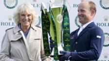 Michael Jung receives the Grand Slam trophy from the Duchess of Cornwall