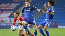 Cardiff's Aron Gunnarson (centre) and Fabio (right) challenge Bristol City's Luke Freeman (left)