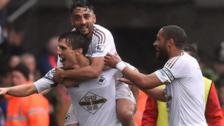 Jack Cork, Neil Taylor and Ashley Williams celebrate a Swansea goal