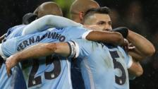 Manchester City players celebrate Sergio Aguero's goal