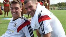 Germany's Mesut Ozil and Lukas Podolski