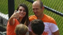 A fan takes a picture with Netherlands player Arjen Robben