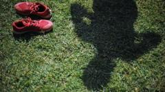 Running trainers and shadow of a man