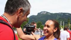Coach Toni Minichello embraces heptathlete Jessica Ennis