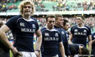 Scotland players look on dejectedly after the loss to England at Twickenham