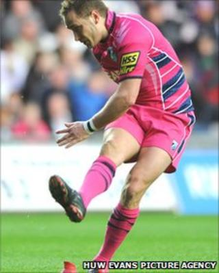 Blues fly-half Dan Parks takes a shot at goal against the Ospreys