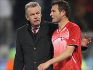 Swiss coach Ottmar Hitzfeld and Alex Frei