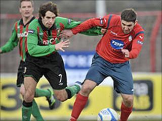 Glentoran's Sean Ward in action against Stephen Carson of Coleraine