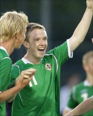 Shane Ferguson celebrates scoring for Northern Ireland in the Milk Cup last year