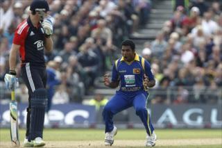 Dhammika Prasad celebrates taking the wicket of Craig Kieswetter