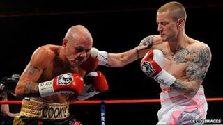 Ricky Burns lands a right on Nicky Cook