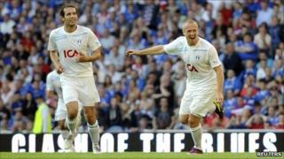 Larsson (right) celebrates his well-taken opener after 18 minutes